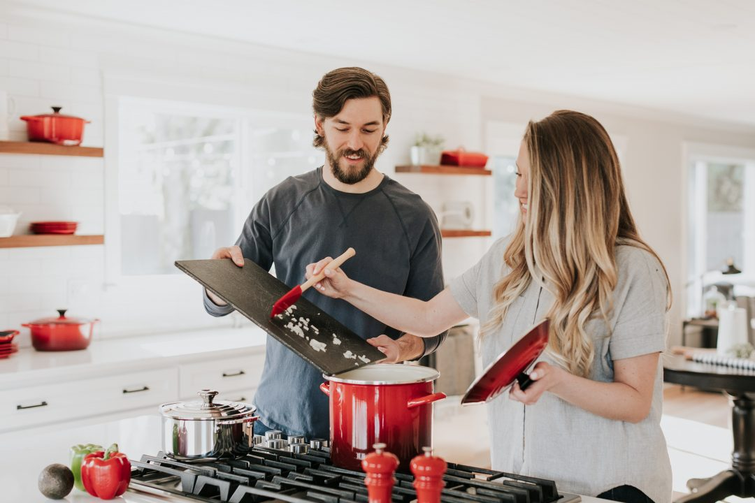 Couple in their kitchen, cooking dinner together